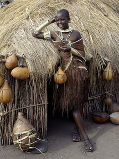 Datoga Woman Relaxes Outside Her Thatched House, Tanzania Photographic Print by . Datoga Woman Relaxes Outside Her Thatched House, Tanzania Photographic Print by Nigel Pavitt - Architektur