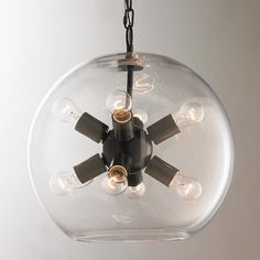 "Orbit Glass Sphere Chandelier Eight lights cluster inside a clear glass globe for a clearly modern update to the sputnik story in this mini chandelier. 8 x 15 watts medium base sockets. (18""Hx16""W)"