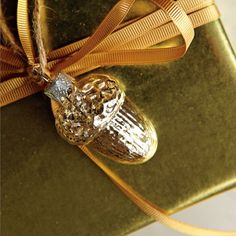 Wrapping with acorn ornaments.