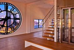 This amazing 7,000 square foot penthouse apartment is located in the 1914 landmark clock tower building in New York.   Beautiful apartment features unique staircase, private 3-story elevator, modern kitchen, three bedrooms, and four giant clocks with glass faces that offer breathtaking panoramic views.  Clock Tower apartment is currently for sale for only 23,500,000 dollars