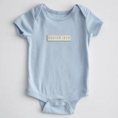 "Baby gift idea...onesie that says baby's name and ""Est.2012"""