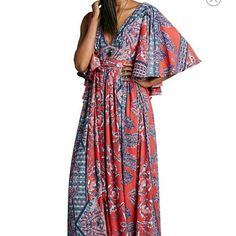 "(Free People) ""Fern"" Maxi Dress Beautifully sweeping maxi dress featuring vertical bands of alternating patterns create an ornate effect in an ultra-drapey, goddess-like maxi dress styled with a deep V-neckline and fluttery split elbow-length sleeves. A thigh-high side slit reveals intriguing flashes of leg as you strut in this look fit for a queen. Hidden side-zip closure; waist-tie.V-neck.Split elbow-length sleeves.Side slit.Lined.  ***Sorry no trades*** Currently selling at Nordstroms for…"