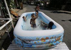 IMAGEM DA SEMANA : O calor está tão grande que a piscina é colocada n...