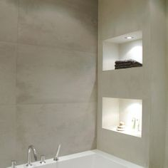 I like the concrete and even the faux-concrete tiles... It looks like textured light gray and niches are my preferences. bathroom - modern - bathroom - other metro - April and May