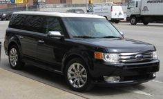 2012 Ford Flex - and to think the Country Squire Station Wagon was replaced with this monstrosity! I'll take a ride in one... probably when I'm dead.