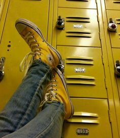 "The satisfaction of the yellow sneakers and the lockers being almost the same shade made the owner if the yellow sneakers ask herself, ""have my feet dissolved into the lockers?"""