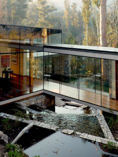 Built on asloping site overlooking the Chilean capital of Santiago, Casa Boher (aka Casa Lo Curro) straddles an irrigation canal which flows under its raised central corridor. The remarkable residence was designed by S3 Schmidt…