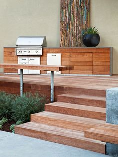 contemporary home exterior design wooden deck and stairs barbeque area