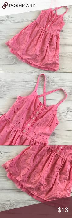 SALE! Pink dress Cotton pink eyelet dress with button detail on the front. Has adjustable shoulder straps, and tutu fringe at the bottom. Fully lined. Excellent condition no rips or stains size Medium 7/8. I have lots of children's clothing check out my closet. ALL ITEMS ARE BUY 3 GET 1 FREE! Dresses