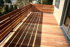 Mahogany contemporary deck, with a modern privacy railing.
