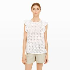 Rousha Eyelet Top - Rendered in a novel circular embroidered design, the Rousha is an eyelet lover's dream. Its crisp cotton construction lends a soft-structured ease, with tiered flutter sleeves and subtle side splits adding movement and shape. Club Monaco, Define Fashion, Flutter Sleeve Top, Ruffle Sleeve, Tiered Tops, Eyelet Top, Lace Tops, Dresser, Cool Outfits