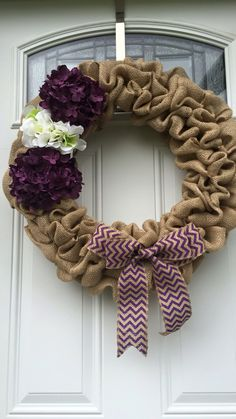 Burlap wreath with purple and white hydrangeas and purple bow