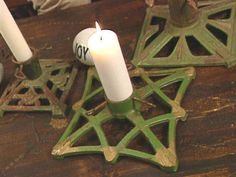 Vintage Christmas tree stands used as candle holders.