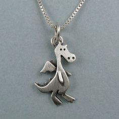 This etsy store has super-cute animal pendants, including a dragon, a snake, a shark, and bunnies!