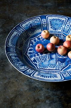 An accessory from Ralph Lauren Home's RLH Collection: the sophisticated RLH porcelain charger, dotted with a handful of fresh-picked apples.