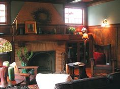 Craftsman living room - fireplace (long thin bricks) with bookcases on either side, each topped with a window.