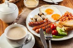 English breakfast with sausage, eggs and beans photo