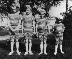 Grand Duchesses Olga, Tatiana, Marie and Anastasia Nikolaevna Romanov in their bathing suits, all ready to go swimming.