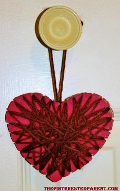 Heart ornament craft for the kids. Made with just cardboard, paint and yarn.Cut slits into your cardboard & weave the yarn around the heart.