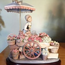 "Lladro Girl with Flower cart ""Flowers of the Season""  #01454 $1200 + $20 S&H"