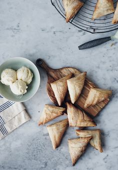 {flavor stories} sweet apple triangles  by Nikole Herriott for Oh Joy (18 sheets frozen phyllo pastry, thawed  1/2 a vanilla pod    1/2 cup apple sauce {store-bought or homemade}  3/4 cup unsalted butter, melted {approximately}  1/3 cup granulated sugar {approximately})