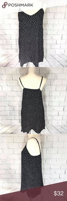 "KENDALL & KYLIE WHITE POLKA DOTS IN BLACK DRESS Light and sexy KENDALL & KYLIE WHITE POLKA DOTS IN BLACK DRESS! Adjustable shoulder strap, vneck and low back. Size:Large Measurements: Chest:   18""     flat across Length:28"" -Materials:100% Rayon -Condition:Brand New with Tag MSRP$39.95+tax      +tax Bundle up and save!No Trades please Reasonable offers are welcome.  *Christian J. -Posh Ambassador;Posh Compliant *500+ Items listed, check out and shop!  *N2 Kendall & Kylie Dresses"