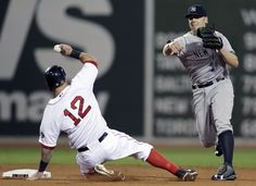 Boston Red Sox first baseman Mike Napoli (12) slides out on a fielder's choice as New York Yankees' Brendan Ryan, right, tries to throw to f...