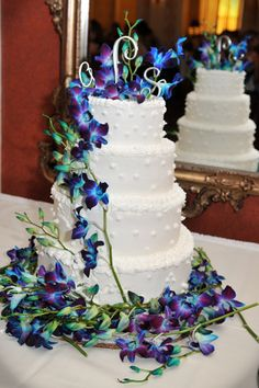 This was a MUST pin....stunning blue orchids surrounding a stunning white cake.....