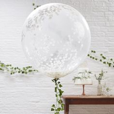 Beautiful jumbo clear balloons filled with white tissue confetti dots. Perfect wedding and party decor, these are a perfect match with our decorative vines as tails. Balloon size 90cm. Confetti dots are 2.5cm each. 3 per pack. HELIUM INSTRUCTIONS: Helium filled balloons can float for up to 12 hours, however this is dependant on how they are handled, transported