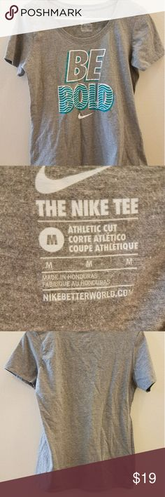 """Nike T! This is a gray t shirt with a scoop neck. """"Be Bold"""" is on the front In white and teal letters! Medium sized. Brand New! Could be warn to work out in or with some jeans 😊💕💕 Nike Tops Tees - Short Sleeve"""