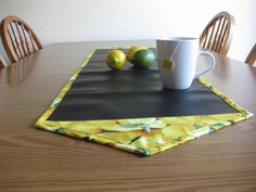 Lemon Chalk Cloth Table Runner   The teacher in me still loves writing in chalk! And chalk cloth is a versatile fiber-backed surface you can write on and wipe clean. This runner measures 14 x 48 and is  reversible, functional and perfect for entertaining. What a great way to label dips, cheeses or desserts on a buffet. And when a piece of chalk is left out on the table, guests can add their creativity, too.  #Chalkcloth