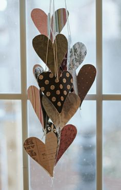 Paper hearts- Nice toppers.  Would work with simple flower shapes, too.