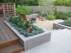 cool-outdoor-fireplace-and-modern-desert-landscaping-with-concrete-garden-bed-plus-little-sand-591x443