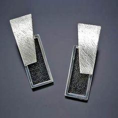 """Artist: Davide Bigazzi: Embrace, Earrings in sterling silver. Approx 1 1/2 x 1/2"""" each."""