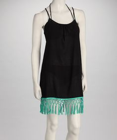 Crinkly cotton makes a comfy cover-up for a sun-drenched day. This black dress wafts down to a chain-woven teal fringe for a piece that will help a suit sail from sun-basking to evening mingling. 100% cottonMachine washImported