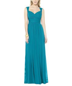 DescriptionAfter Six Style 6712Full length bridesmaid dressSweetheart neckline with strapsCrisscross ruched bodiceShirred waistband at empire waistSkirt gathers at waistline and has a side front slitLux chiffon