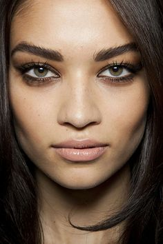 15 Nude Lipstick Looks That Are Perfect for Fall | Daily Makeover - A satiny beige lip plays up the edginess of a slightly smeared black liner look.