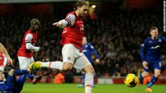 Late goals keep Arsenal top of the English Premier League