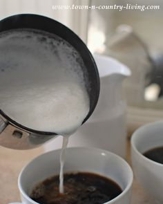 Frothed milk for cappuccino by Town and Country Living