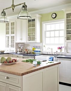 This kitchen sings with the perfect shade of green, Benjamin Moore's Chameleon. Read more: Kitchen Decorating Pictures - Decorating Ideas for Kitchen - Country Living Green Kitchen, New Kitchen, Kitchen Dining, Kitchen Decor, Kitchen Paint, Kitchen Walls, Kitchen White, Awesome Kitchen, Kitchen Interior