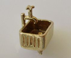 9ct Gold Butler Sink and Tap Charm by TrueVintageCharms on Etsy https://www.etsy.com/au/listing/509071560/9ct-gold-butler-sink-and-tap-charm