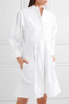 White cotton-poplin Button fastenings along front 100% cotton Dry clean Imported