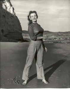 1945 Beach Sitting - Red Sweater - Norma Jeane by André De Dienes