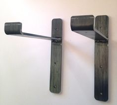 Mid-century modern shelf brackets for 2x10 shelfs. Modern industrial style very heavy duty shelf brackets. Ideal and made for large 2x 10 wood shelves. Fits in great in so many decoration styes and types. A custom and unique sleek steel shelving system. Industrial Chic  ***This is for one bracket. You will need to order the amount (qty.) as needed. This is Not a set.  13 X 10 - 2 wide strap 1/4 thick! This is the real deal, you can park a car on it!  Double welded for added strength. Made in…