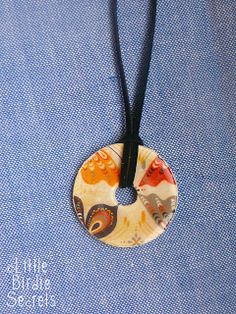 washer necklaces....mod podge...scrapbook paper...washers....yeah....pretty awesome :)