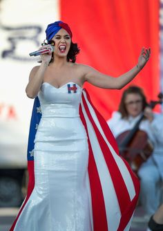 Pin for Later: You Have to See the Early Birthday Present Katy Perry Gave Hillary Clinton  Katy performed at the Iowa rally, showing off her strapless sequinned dress and American flag cape and head wrap.