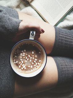 Enjoying a book and hot chocolate