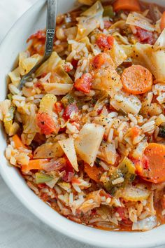 A very healthy and easy to make Rice And Cabbage in a light tomato sauce loaded with veggies!