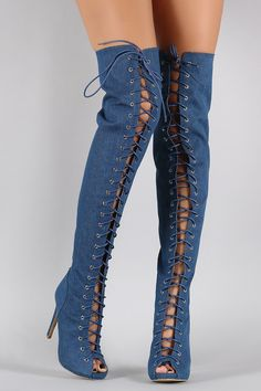 """Description These stunning  over-the-knee boots  feature a peep toe silhouette, corset style lace up detail, low hidden platform, and wrapped stiletto heel. Finished with cushioned insole and full-length rear zipper closure for easy on/off.Material: Denim (man-made)Sole: Synthetic  Measurement Heel Height: 4.5"""" w/ 0.75"""" Platform (approx)Shaft Length: 26.5"""" (including heel)Top Opening Circumference: 16"""" (approx) 