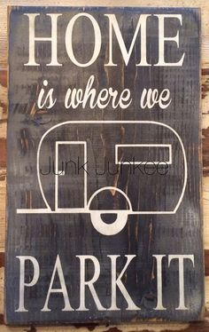 Home Is Where We Park It This sign is on a black distressed background with white stenciled lettering. It would look great in any room or camper